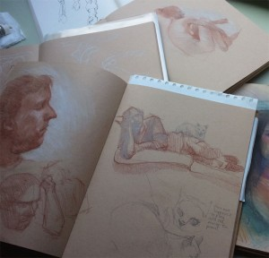 A small pile of sketchbooks